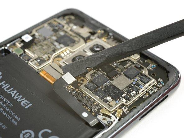 از یک اسپاتول برای قطع کردن ارتباط کابل منعطف باتری استفاده کنید.