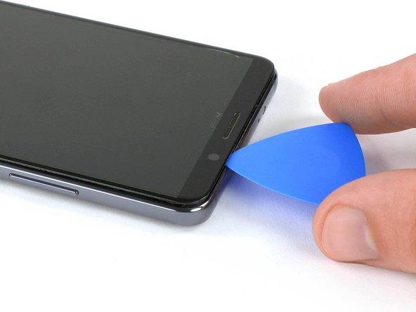 اگر برش زدن چسب دشوار بود، مجددا به کمک iOpener به دستگاه موبایل گرما دهید.