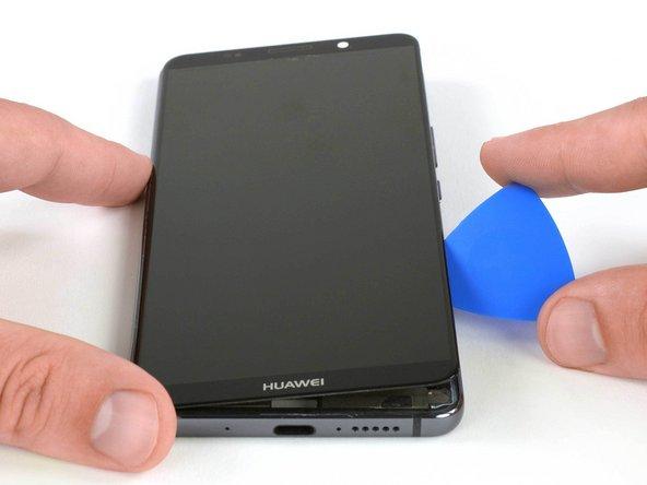 پس از آنکه چسب دور تا دور دستگاه موبایل را برش زدید، قاب بازکن را اندکی بچرخانید تا صفحه نمایش بلند شود.