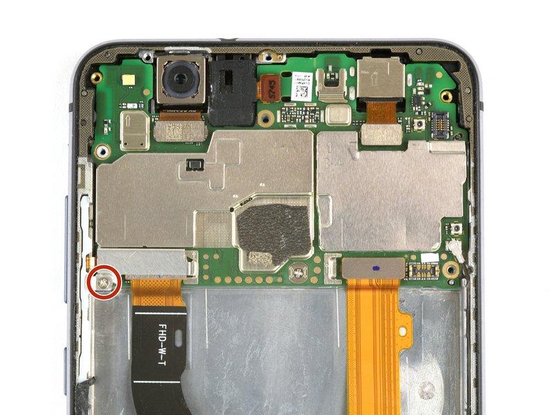پیچ فیلیپسی که براکت متصل کننده صفحه نمایش را در جای خود قرار داده، باز کنید. (پیچی که با رنگ قرمز علامت گذاری شده است)