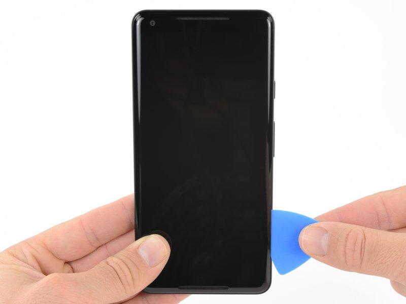 قاببازکن را به لبه سمت راست صفحه نمایش بکشید تا چسبهای این قسمت جدا شوند.