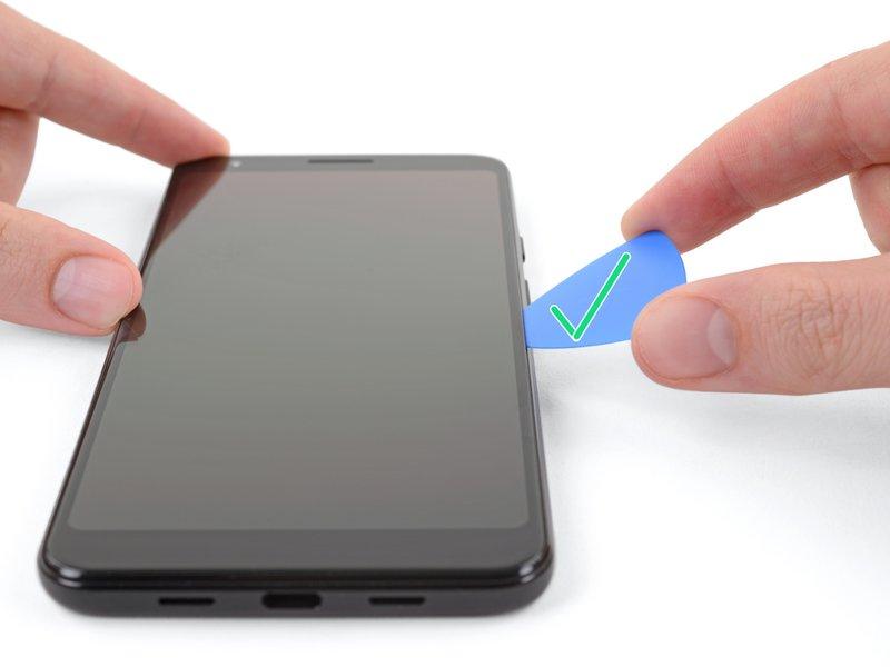 سپس قاببازکن را بالا بکشید، تا یک شکاف بین صفحه نمایش و فریم دستگاه ایجاد شود.